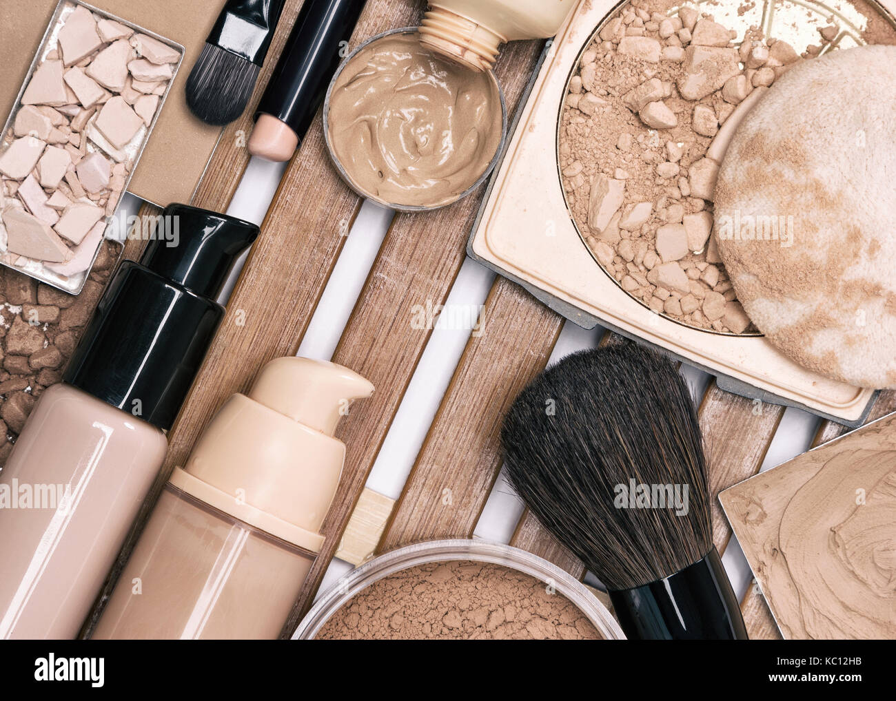 First step of makeup application - foundation products. Concealer stick, primer, liquid and cream foundation, different - Stock Image