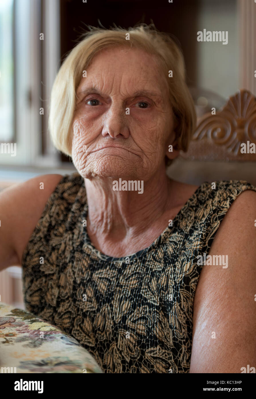 Portrait of confident retired woman looking at camera - Stock Image