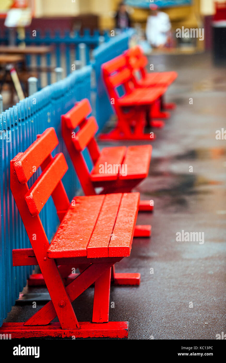 Colorful wooden benches at the Lunapark in Sydney Australia - Stock Image