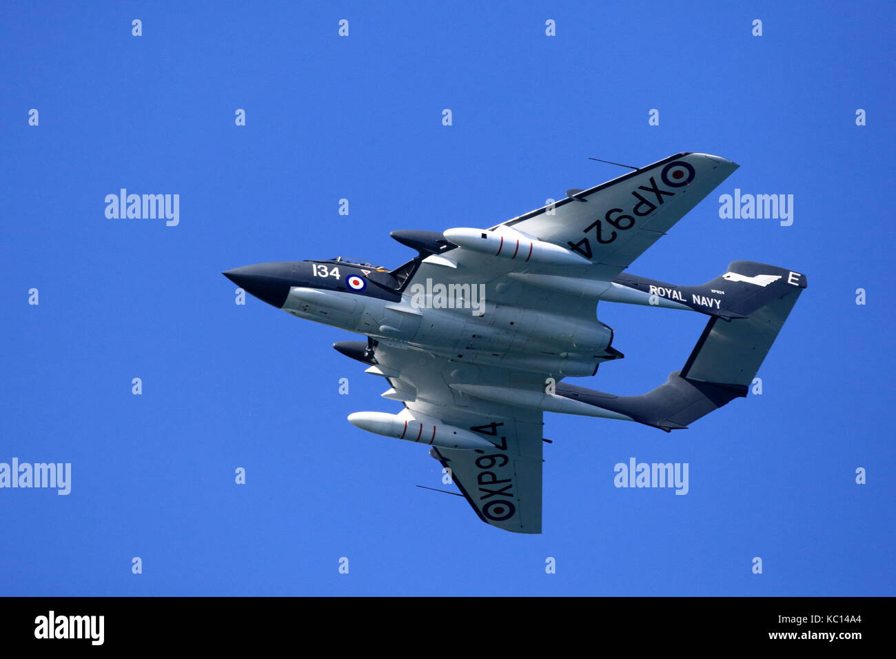The de Havilland Sea Vixen twin boom jet fighter roars closely across the sky at the 2011 Bournemouth Air Festival, - Stock Image