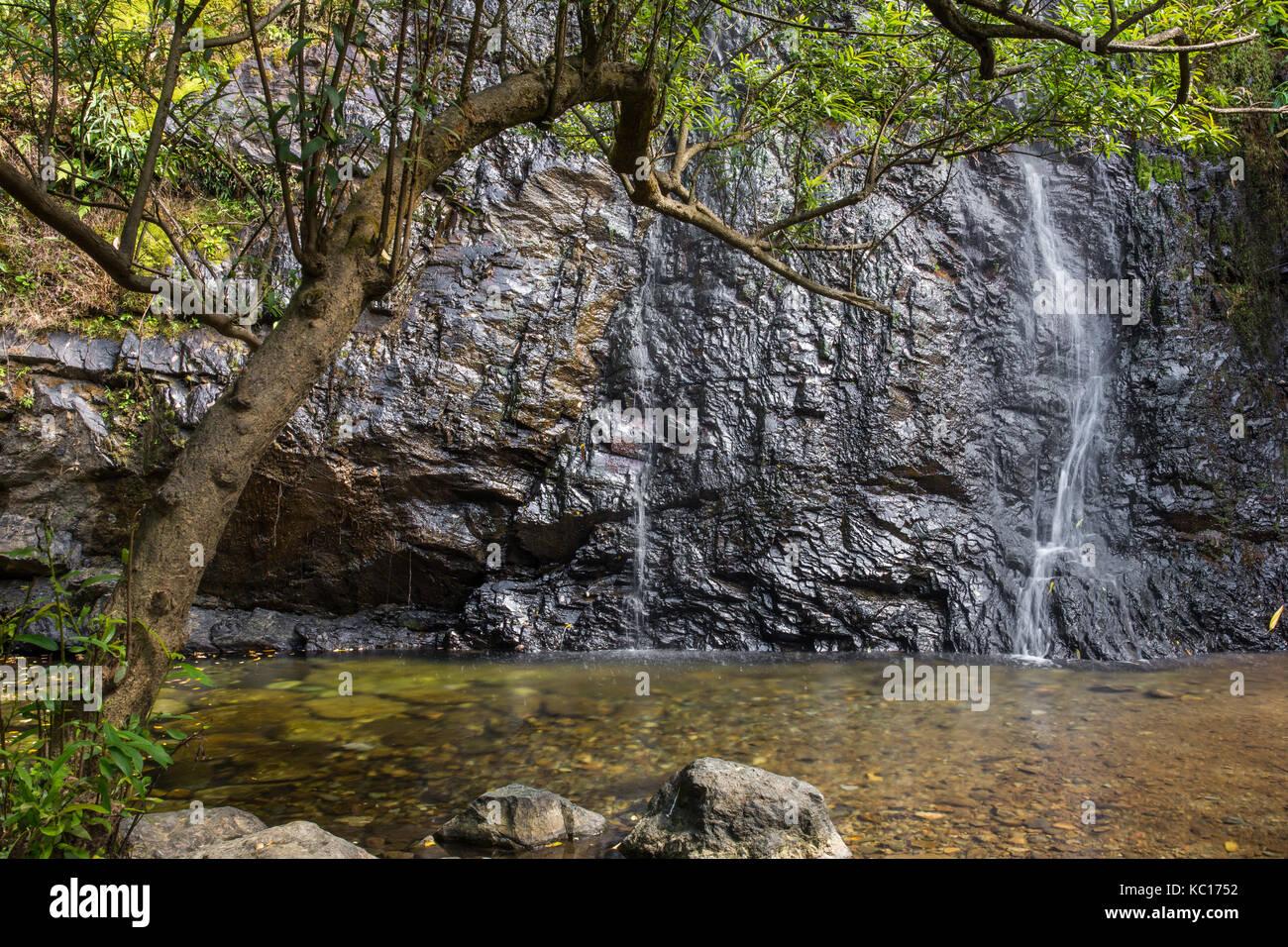 Kaeng nyui waterfall in Vang Vieng, Laos. Tropical rainforest landscape with beautiful waterfall, rocks and jungle Stock Photo