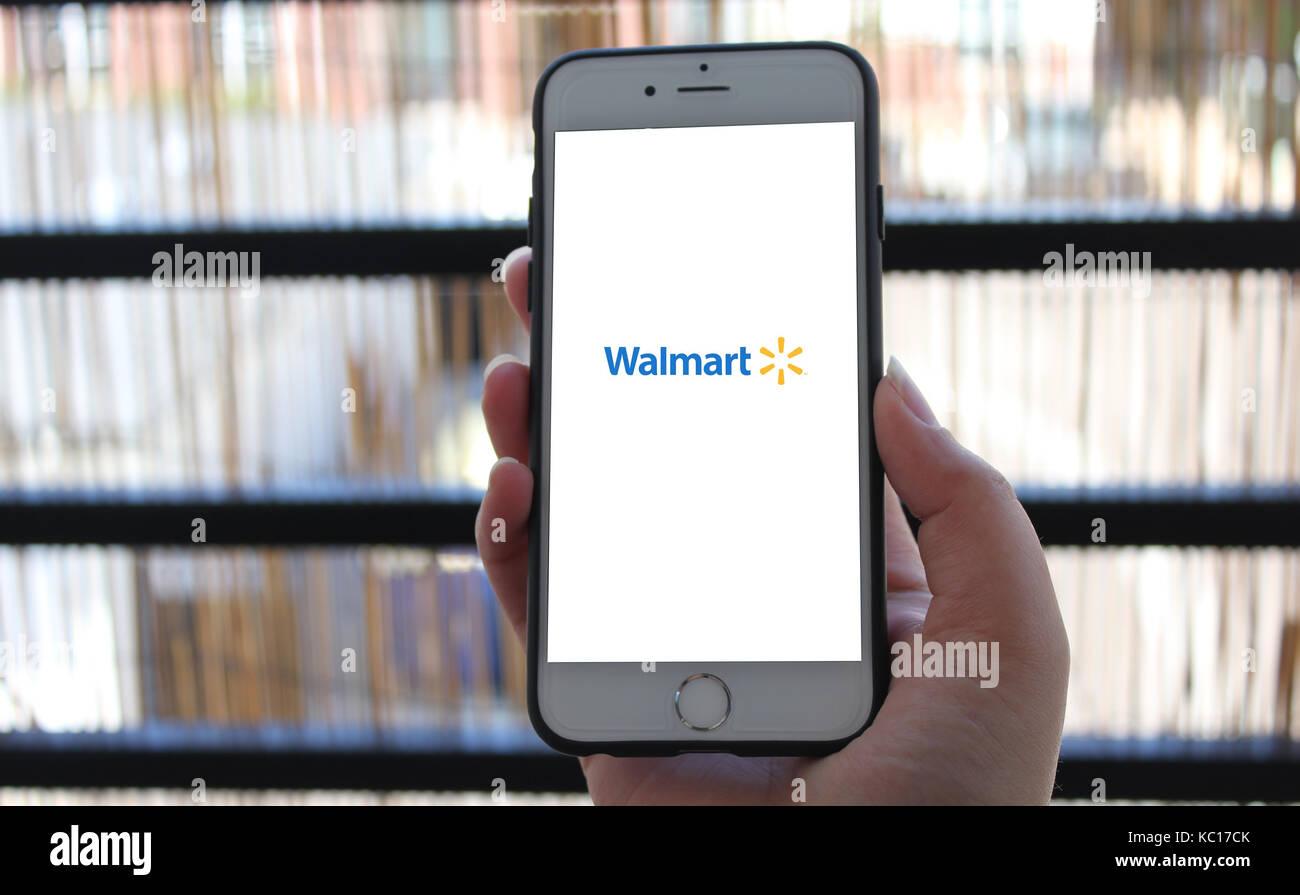 Walmart Stock Phone Number >> Consumer Holding Phone With Walmart Logo Stock Photo 162296979 Alamy