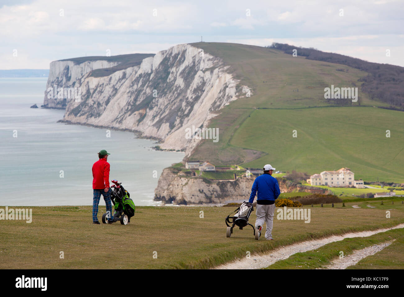 Golf, playing, course, links, downs, down, players, twosome, two, double, club, clubs, trolley, electric, cart, - Stock Image