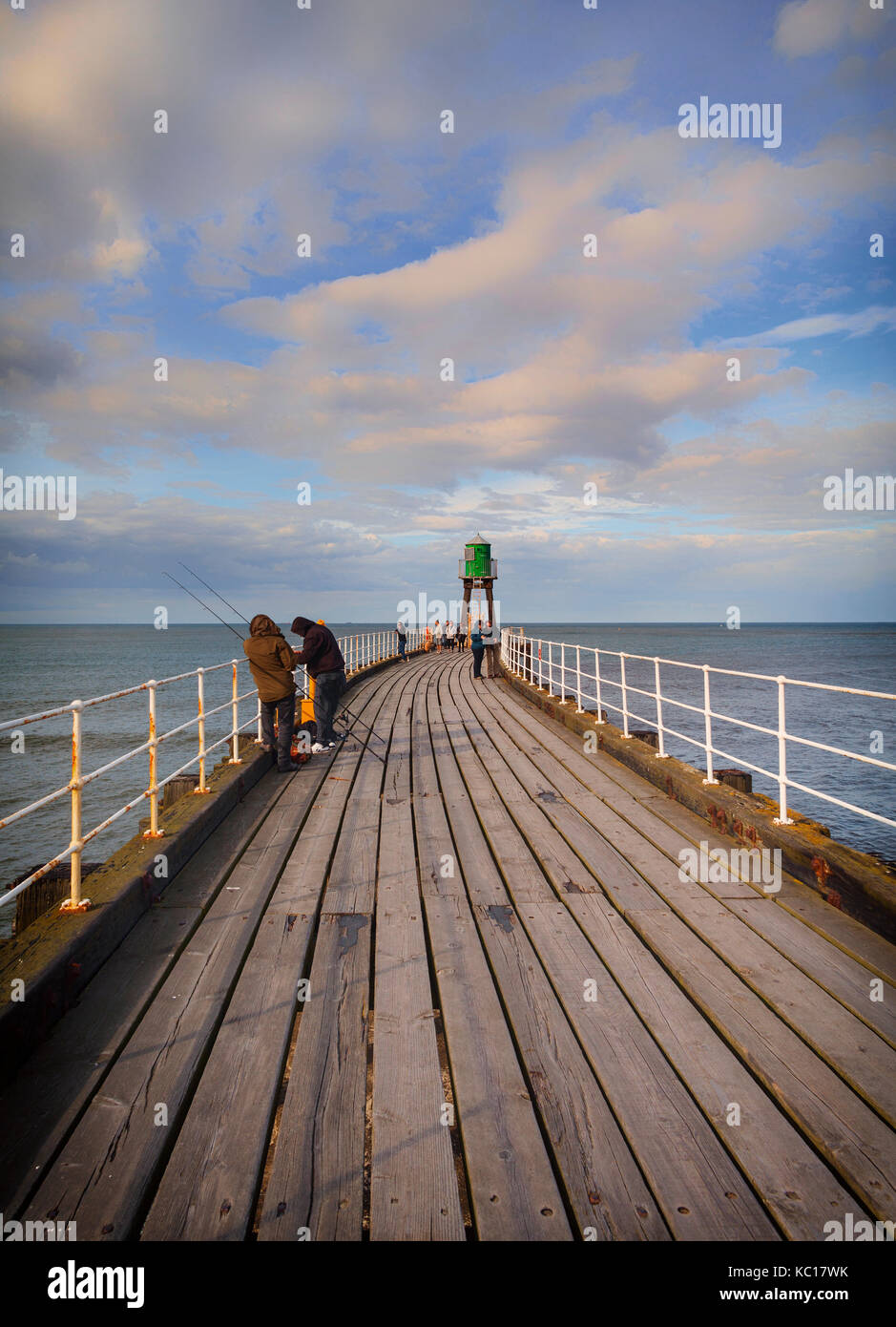 Visitors, Fishermen on the West Pier Extension  built 1908 - 1914 at  Whitby harbour entrance, North Yorkshire, - Stock Image