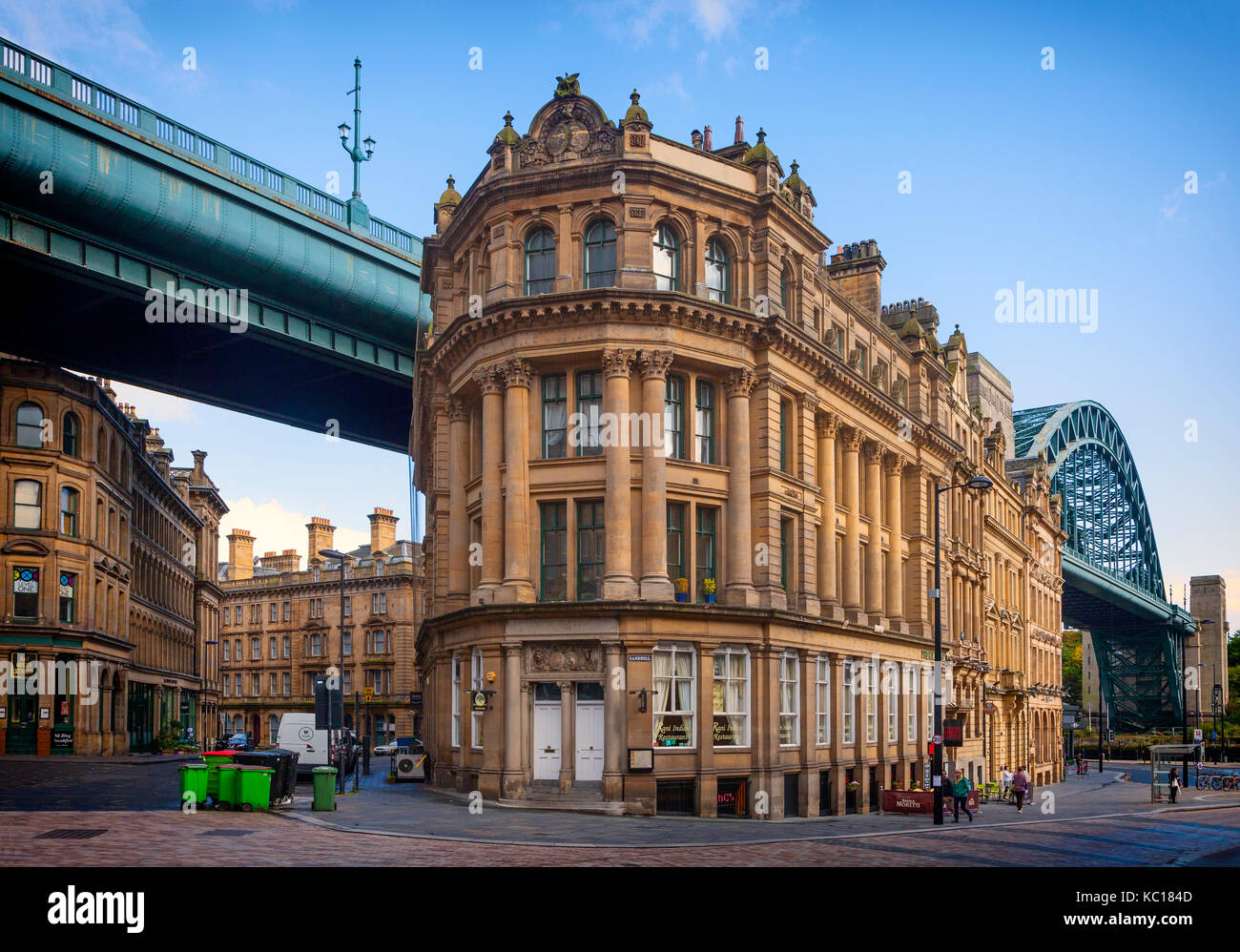 The Phoenix Apartments, Queen Street/Lombard Street dwarfed by the Tyne Road Bridge opened 1928, Newcastle upon - Stock Image
