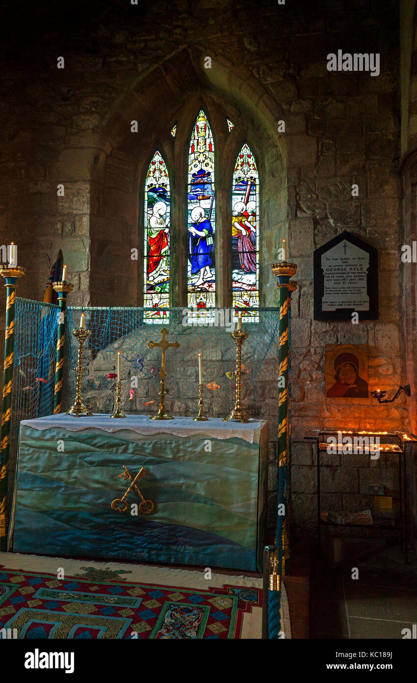 The 'Fishermen's Aisle'with St. Peter's altaBIBLr in the 12th Century Anglican 'Parish Church - Stock Image