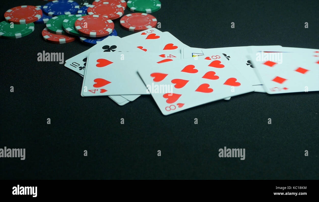 Falling playing or poker cards. Close up of falling playing cards poker game on black background with clipping path. - Stock Image