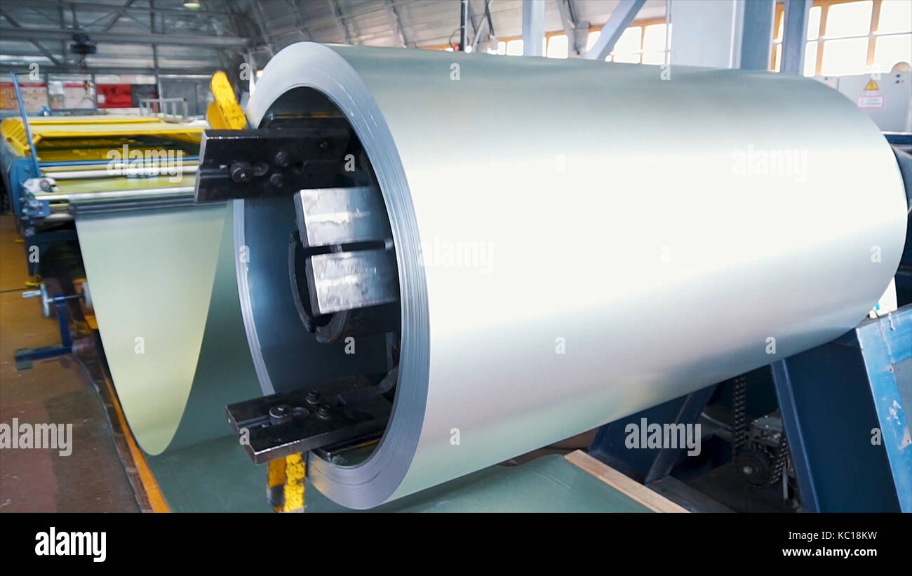 Rolled steel. Stack of rolls, Cold rolled steel coils in action. Galvanized Steel Sheet and rusty rim. Cold rolled - Stock Image