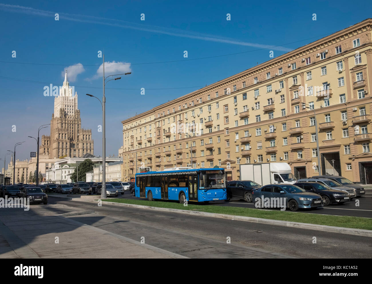 Moscow street scene with apartment block and traffic, and Ministry of Foreign Affairs of Russia main building, Smolenskaya - Stock Image