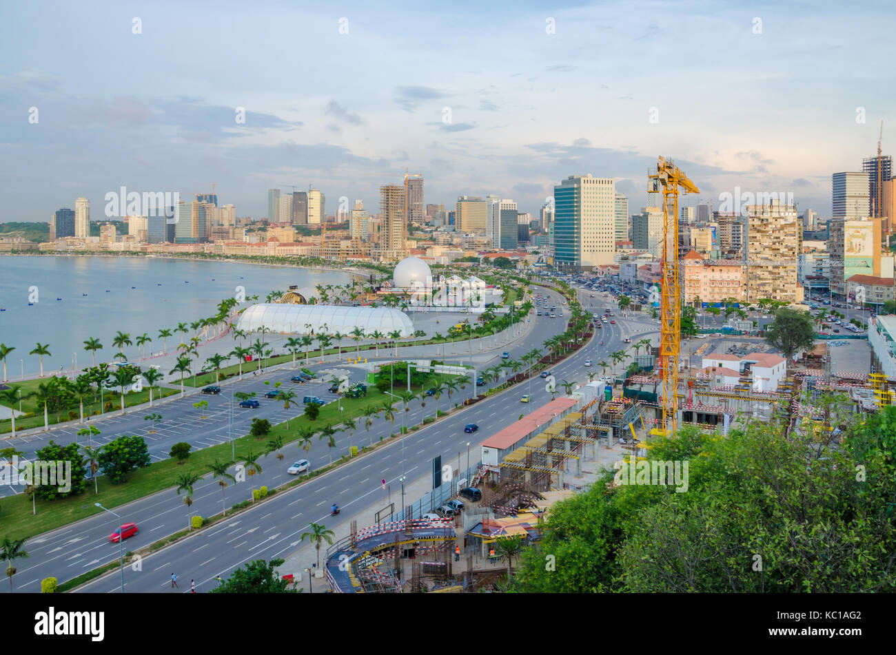 View over the skyline of Luanda with constructions cranes, highway and the Luandan bay, Angola, Southern Africa - Stock Image