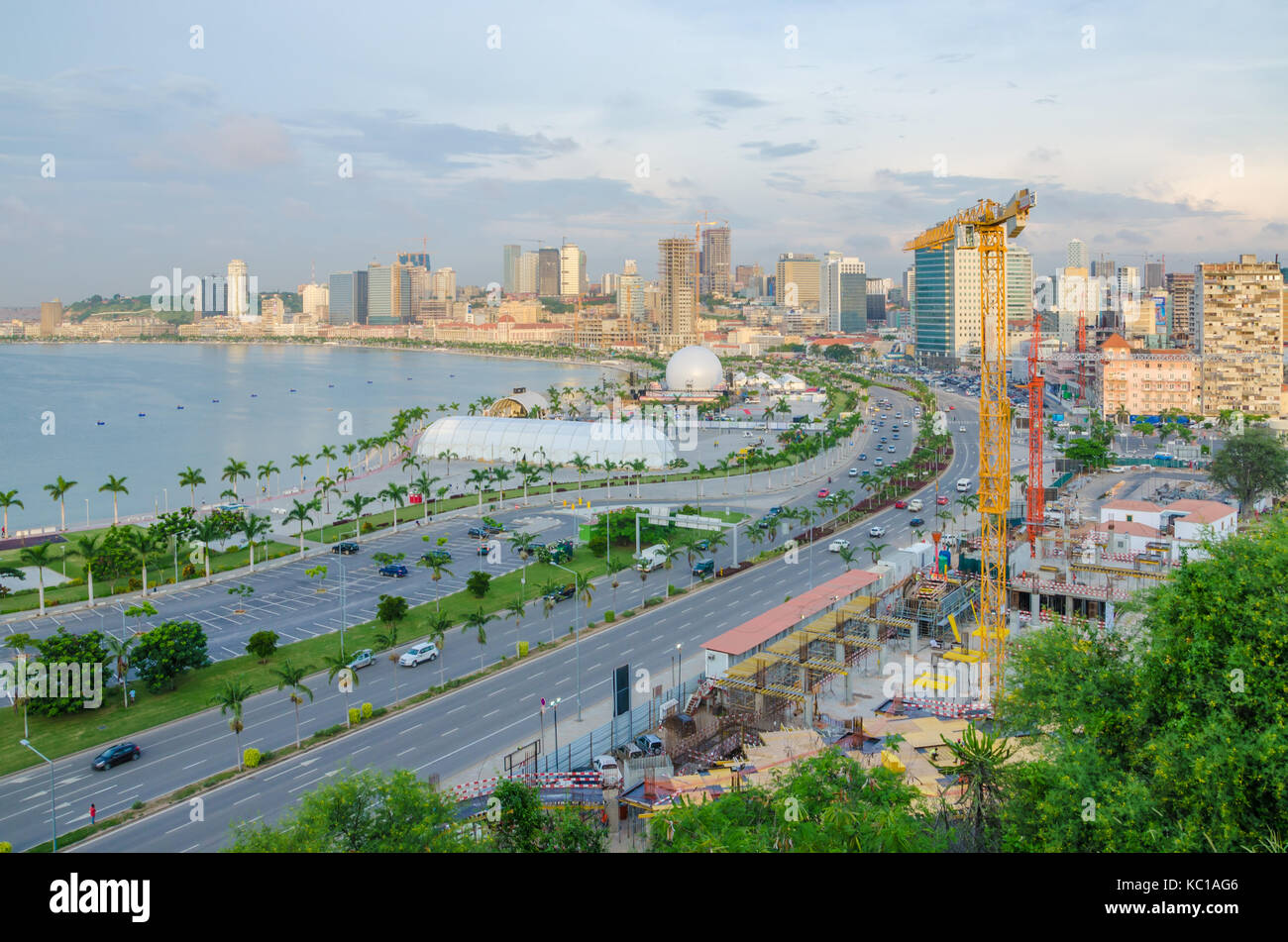 View over the skyline of Luanda with constructions cranes, highway and the Luandan bay, Angola, Southern Africa Stock Photo