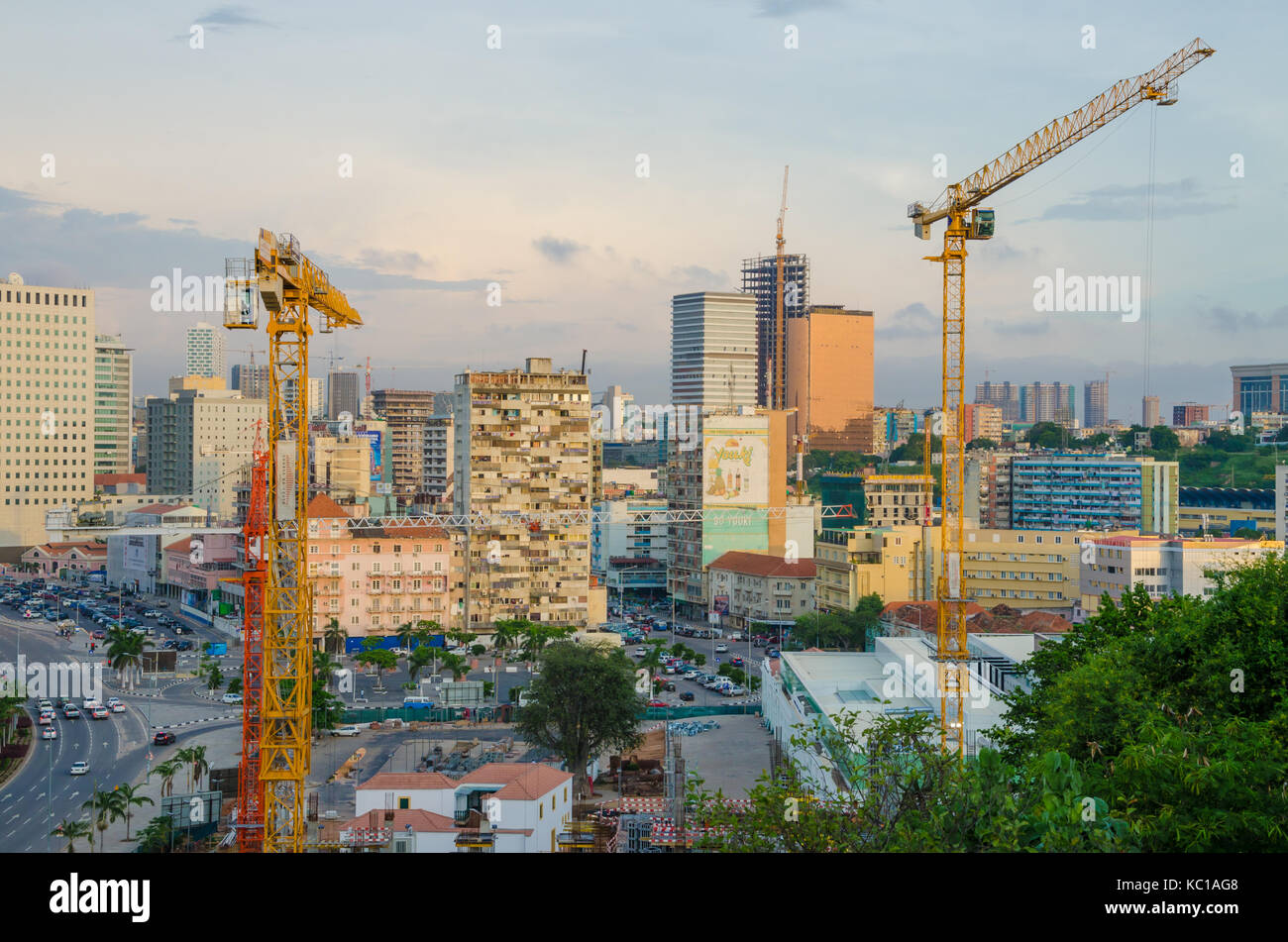 View over the skyline of Luanda with constructions cranes, modern buildings and highway, Angola, Southern Africa - Stock Image