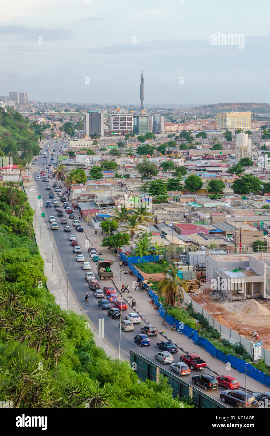 View over slums of Luanda with infamous traffic jams and Mausoleum of Agostinho Neto, Luanda, Angola, Africa - Stock Image