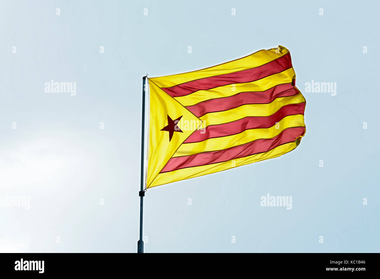 Yellow-red flag with five-pointed star. Red 'astalaza' - the flag of the socialist movement of Catalonia - Stock Image