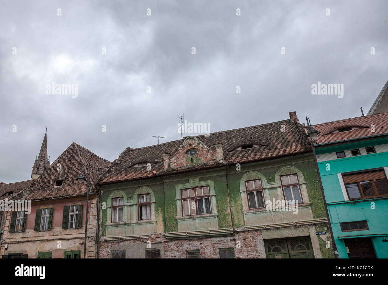 Upper town of Sibiu, in Transylvania, during a cloudy afternoon in a medieval street of the city. The Lutheran Cathedral, Stock Photo