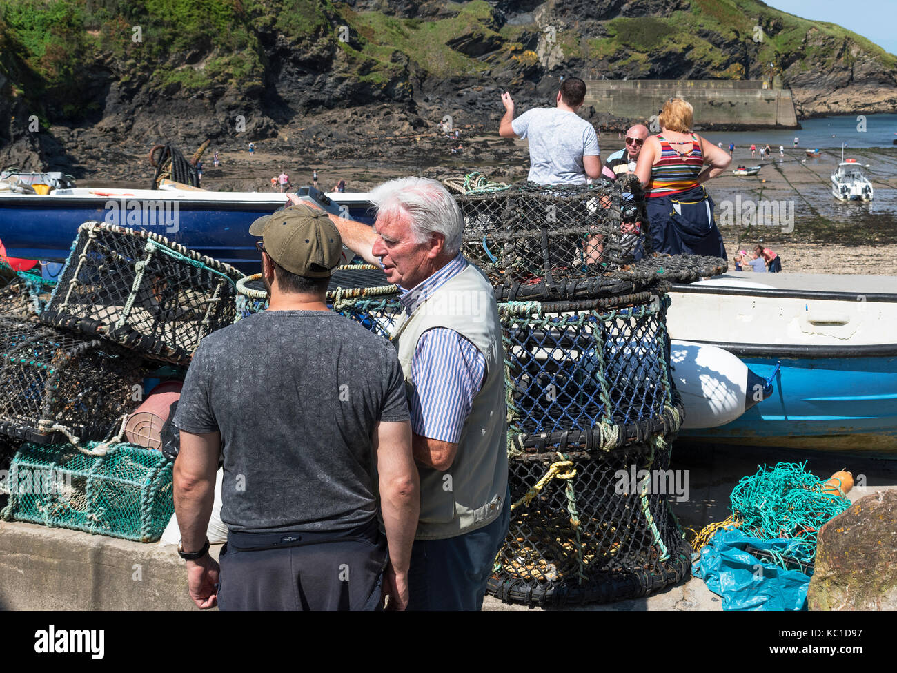 local cornish fishermen at the harbour in port isaac, cornwall, england, britain, uk. - Stock Image