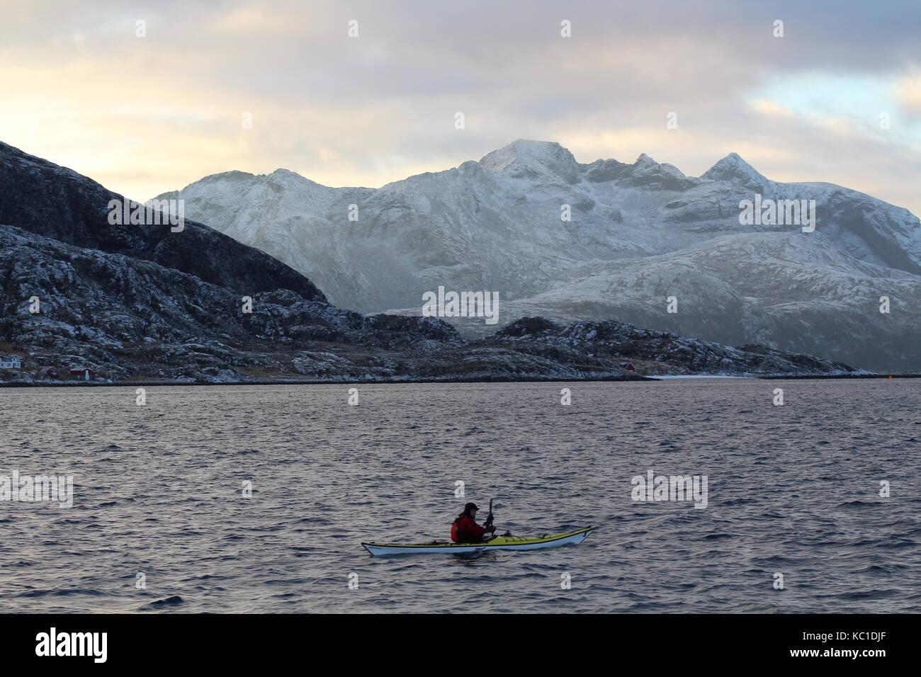 A man in a canoe in the Fjords outside Tromso - Stock Image
