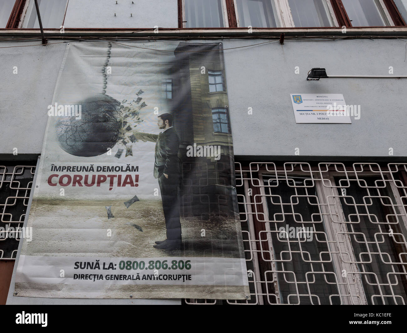 MEDIAS, ROMANIA - SEPTEMBER 22, 2017: Anti Corruption poster displayed on a police station wall in Medias, Transylvania. - Stock Image