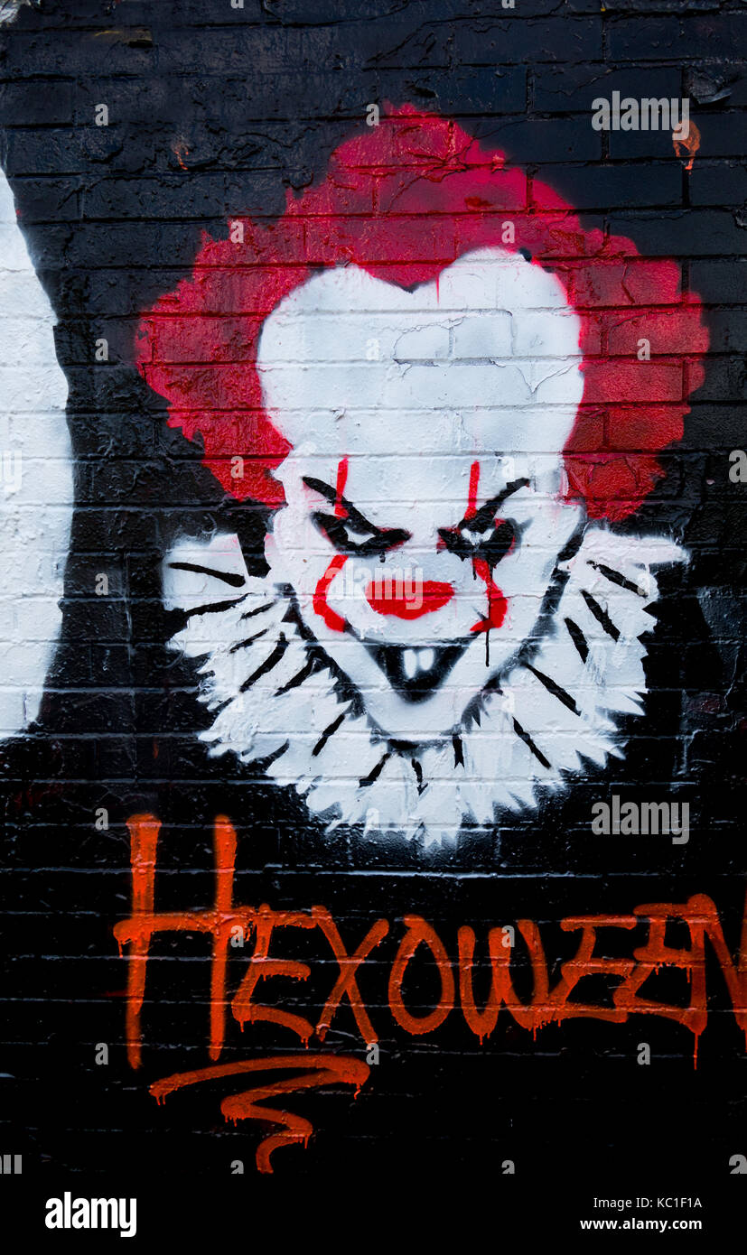 Colorful graffiti on the side of a building themed to represent the Stephen King movie and novel 'It'. - Stock Image