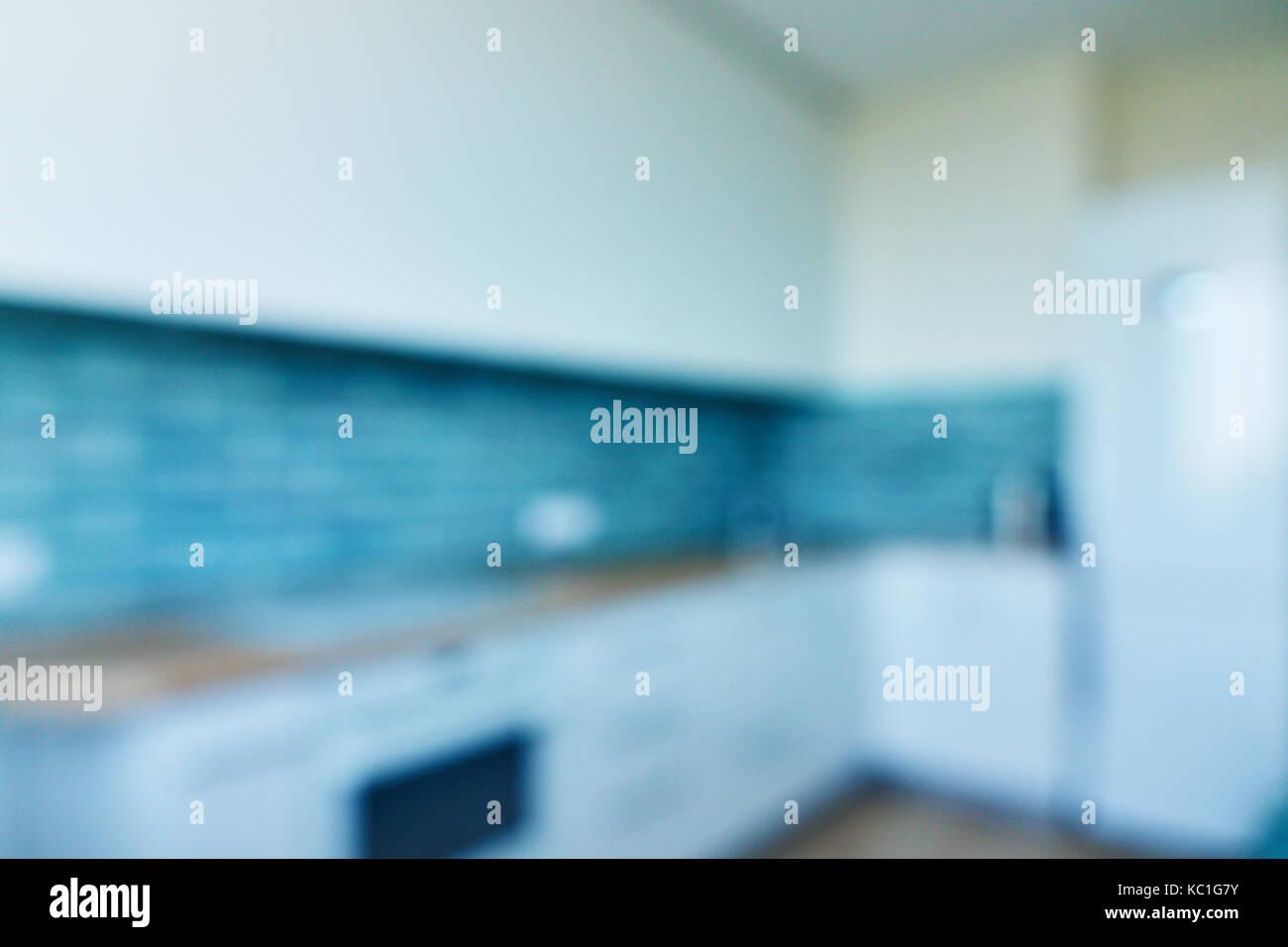 Blur background, white kitchen with blue ceramic tiles Stock Photo ...