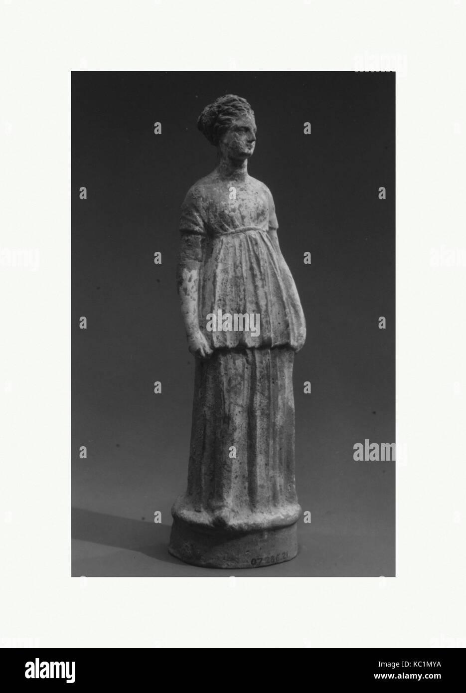 Terracotta statuette of a girl, Hellenistic, 3rd century B.C., Greek, Corinthian, Terracotta, H.: 9 in. (22.9 cm), - Stock Image