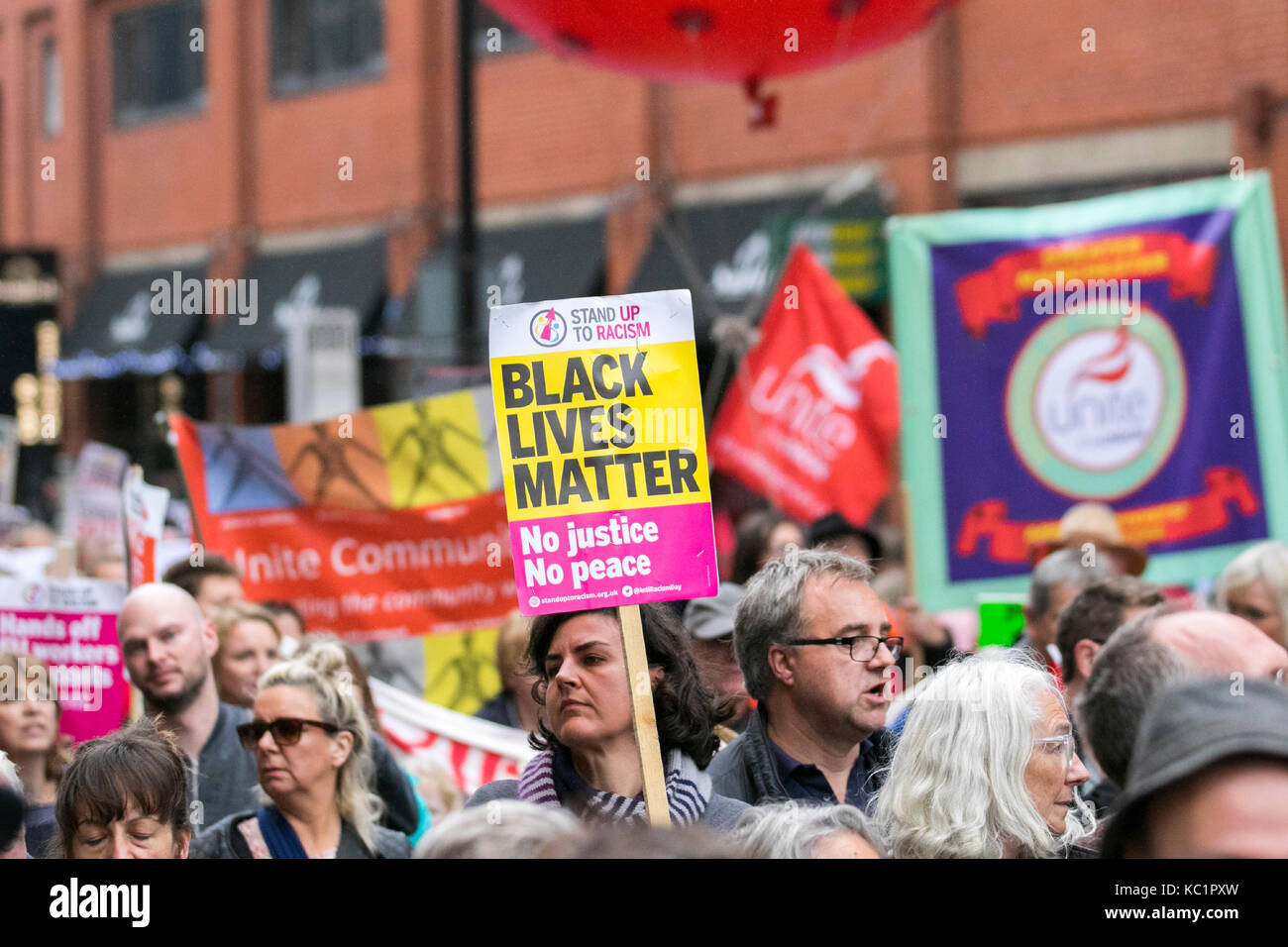 Manchester, UK. 1st October, 2017. Thousands of demonstrators bring the streets of Manchester to a standstill as - Stock Image