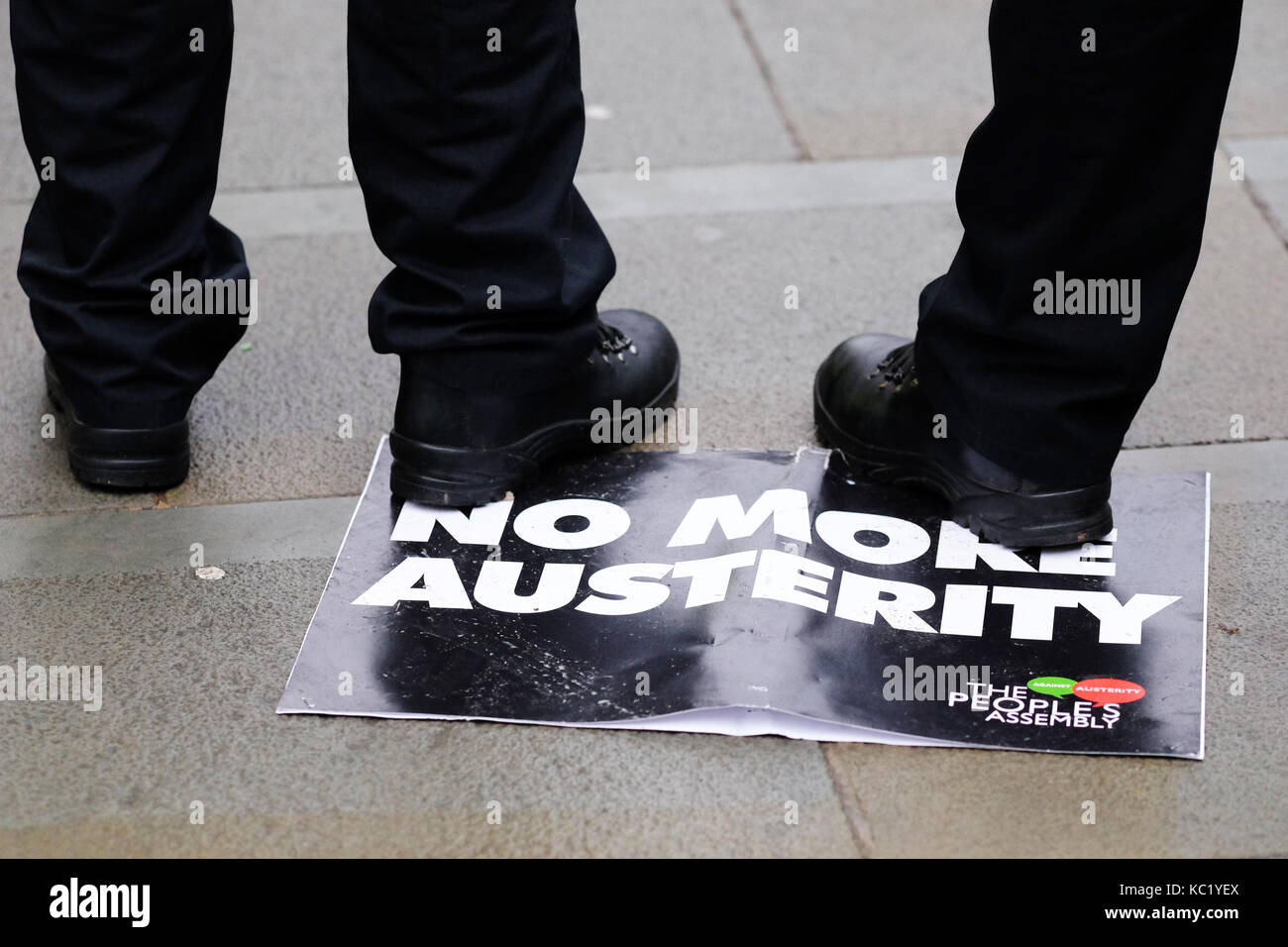 St Peters Square, Manchester, UK - Sunday 1st October 2017 - Police officers stand on a discarded No More Austerity - Stock Image