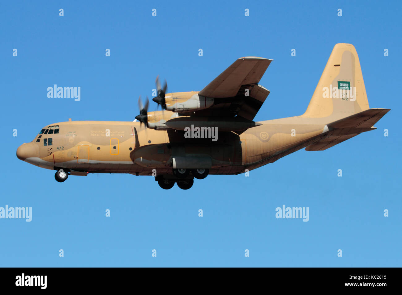 Military air transport. Royal Saudi Air Force Lockheed C-130H Hercules turboprop cargo plane on approach - Stock Image