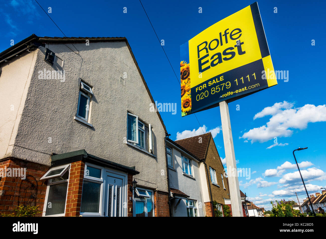 House with a For Sale board outside, via Rolfe East - a local estate agent - in South Ealing, London W5, England, - Stock Image