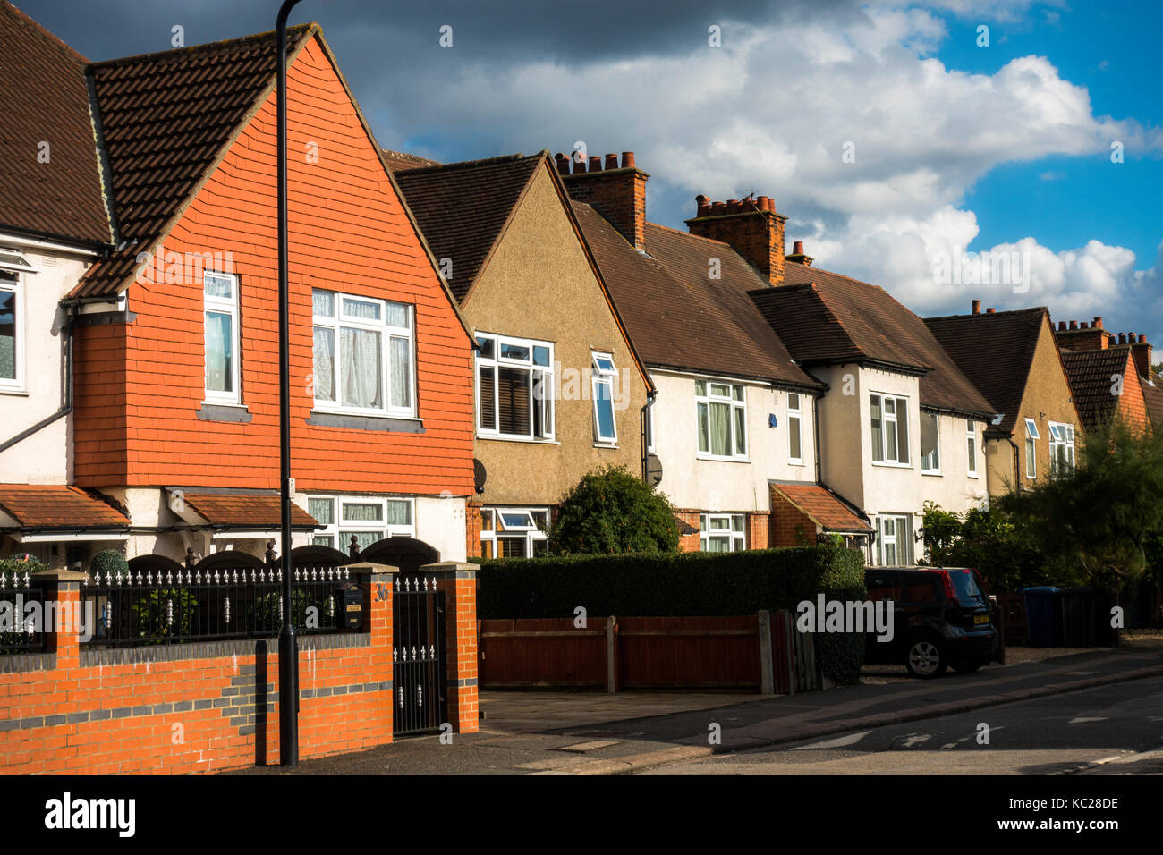 A sunlit row of traditional-build, terraced houses, located on an ex-council estate in South Ealing, London W5, - Stock Image