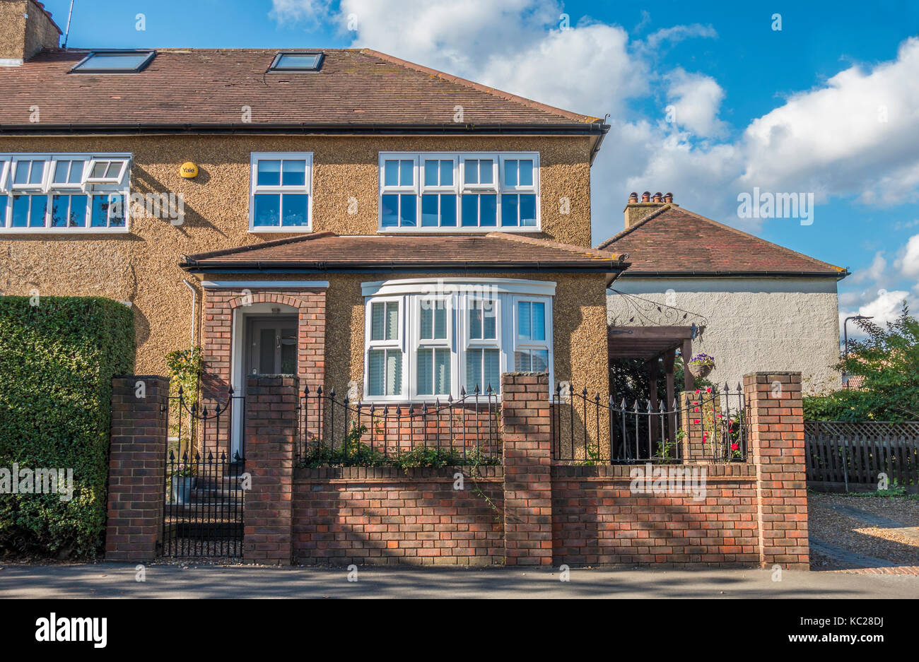 A traditional-build, extended, semi-detached, corner house, located on an ex-council estate in South Ealing, London - Stock Image