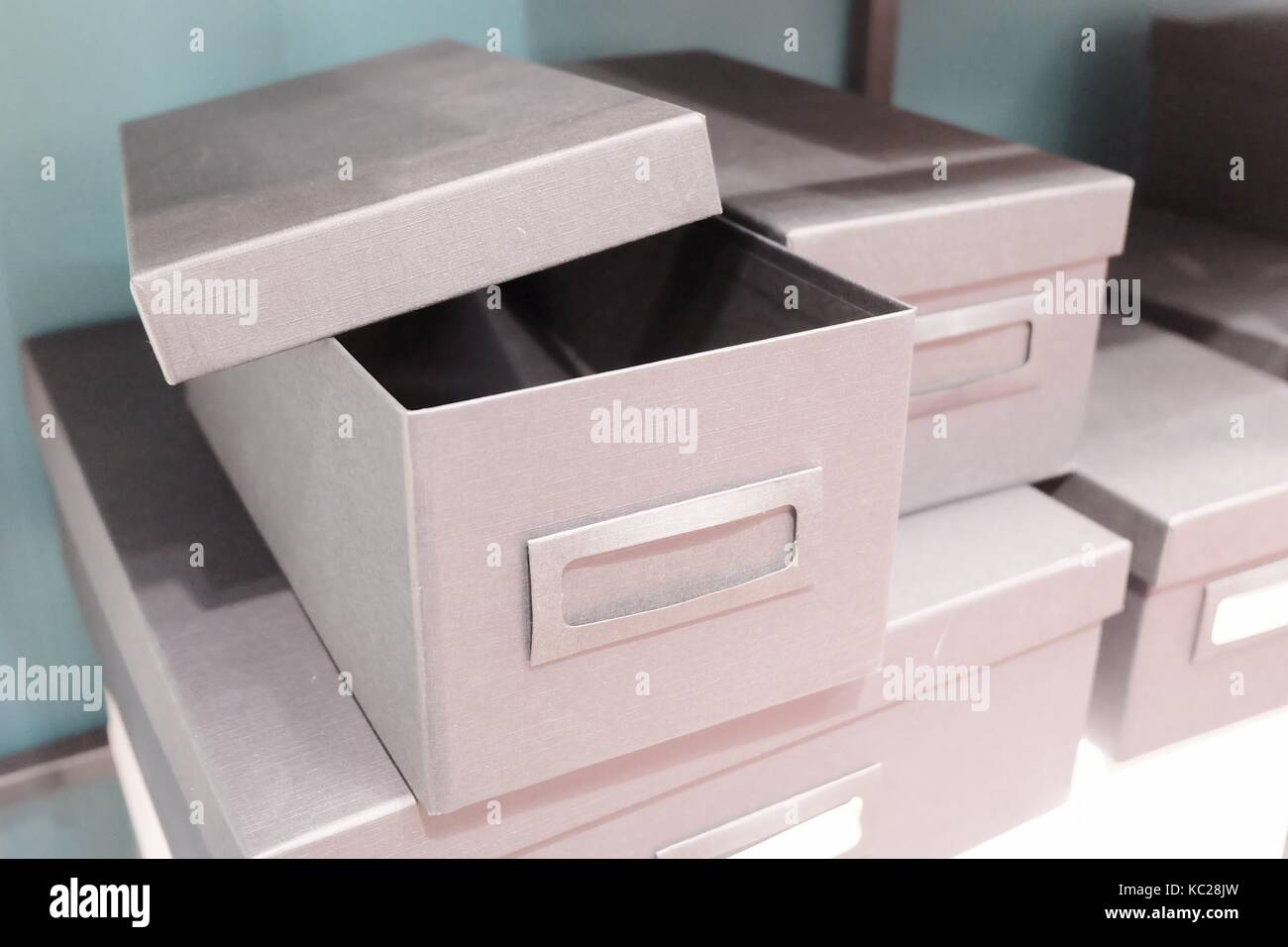 Stack of Empty Office Storage Boxes or Archive Boxes Used for Storing Paper, Media and Accessories. - Stock Image