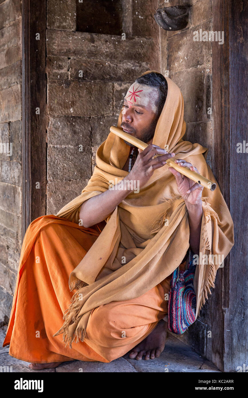 Sadhu or holy man with a flute, Pashupatinath, Kathmandu, Nepal - Stock Image