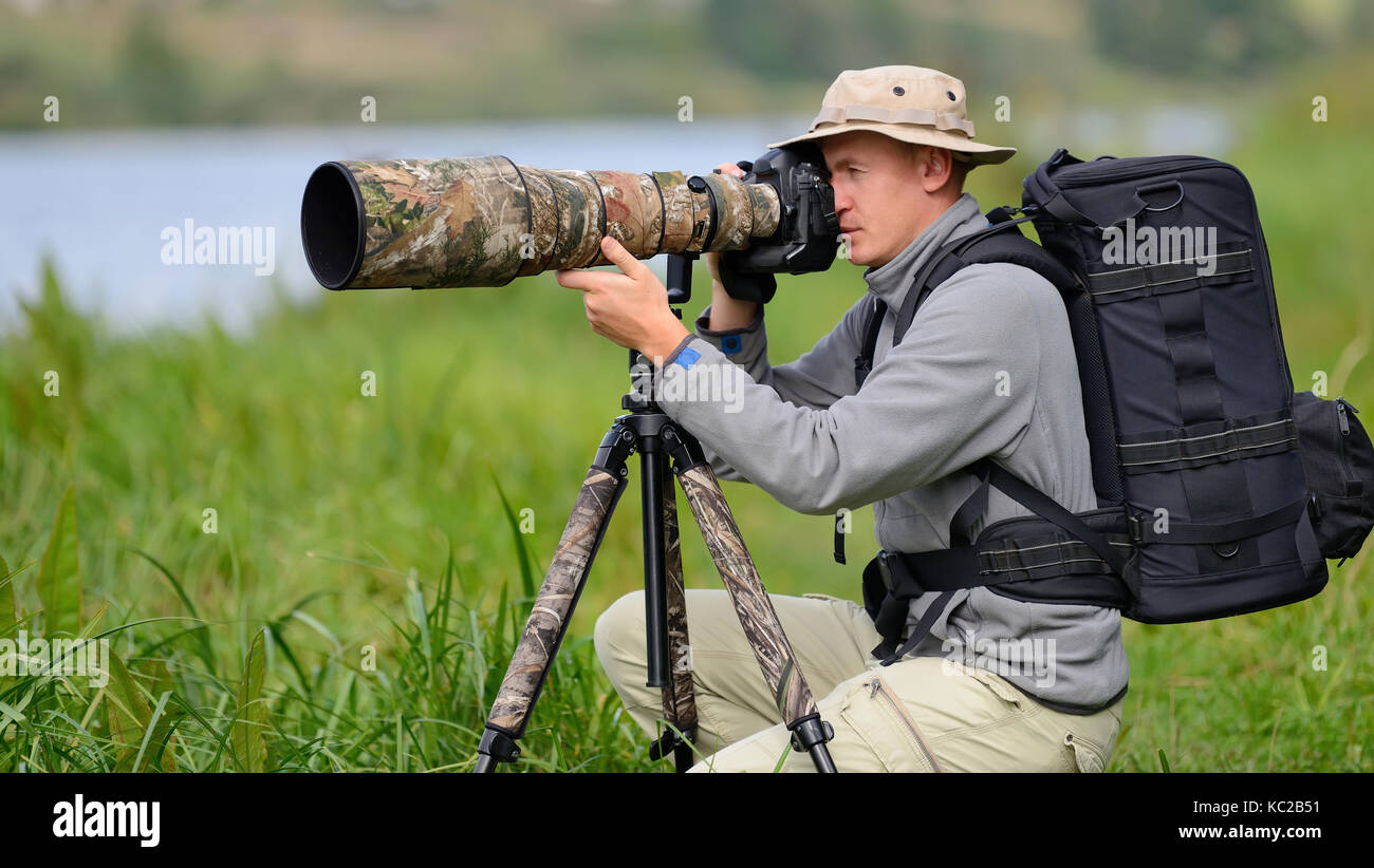 Professional wildlife photographer outdoor - Stock Image