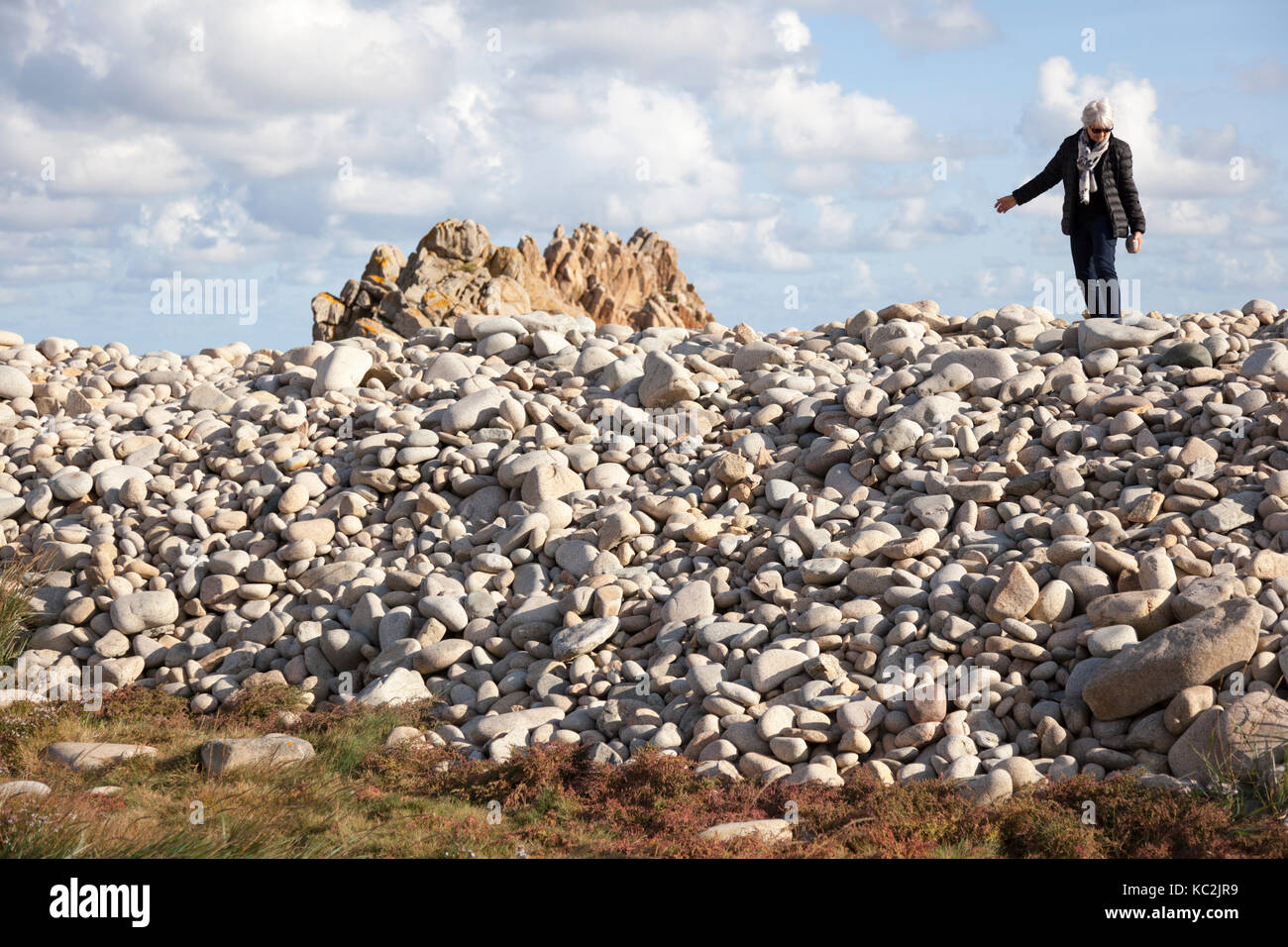 On the North West coast of the Brehat island (Brittany - France),a senior citizen tourist looking for a perfect - Stock Image