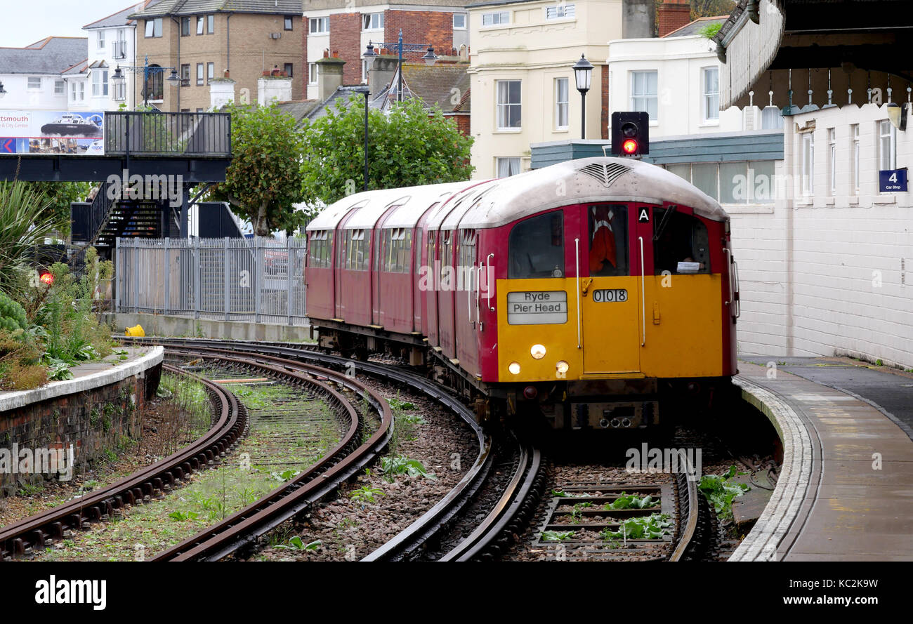 A former London Underground class 483 train arrives at Ryde Railway Station, Ryde, Isle of Wight, England, UK - Stock Image