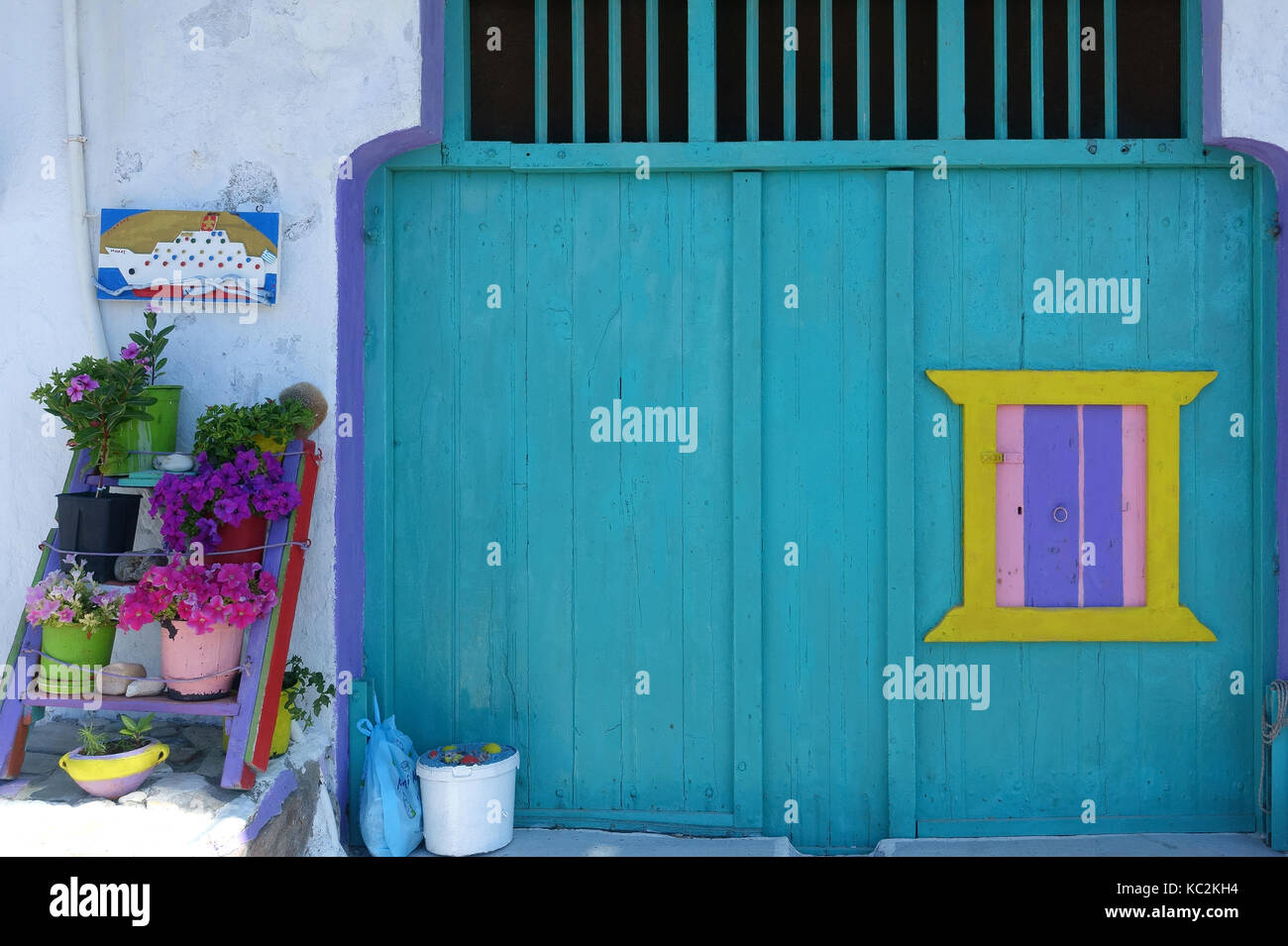 A colourful boat house front in Klima Milos Greece - Stock Image