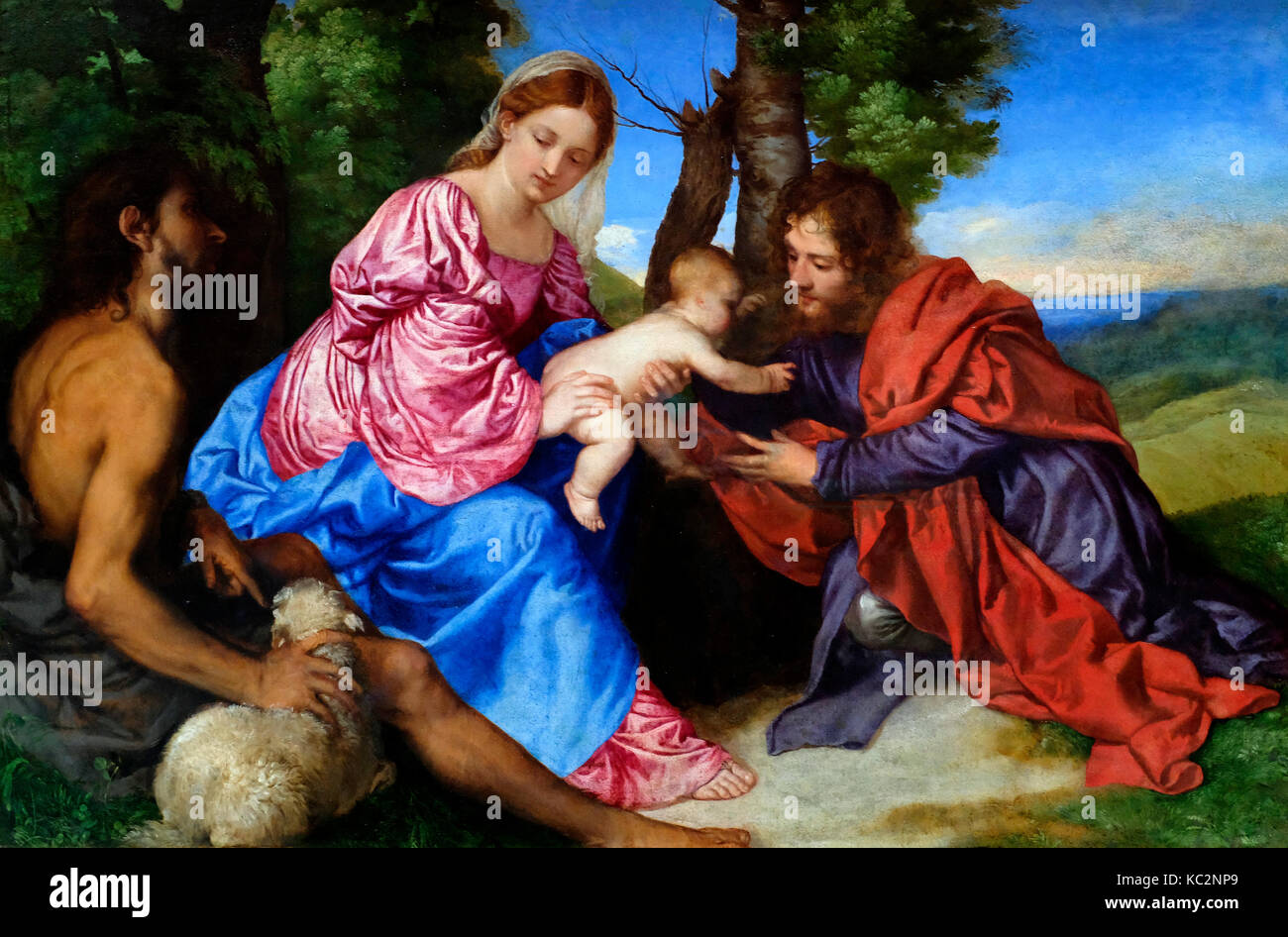 The Virgin and Child in a Landscape with St. John the Baptist and another Male Saint - Titian (Tiziano Vecellio), - Stock Image