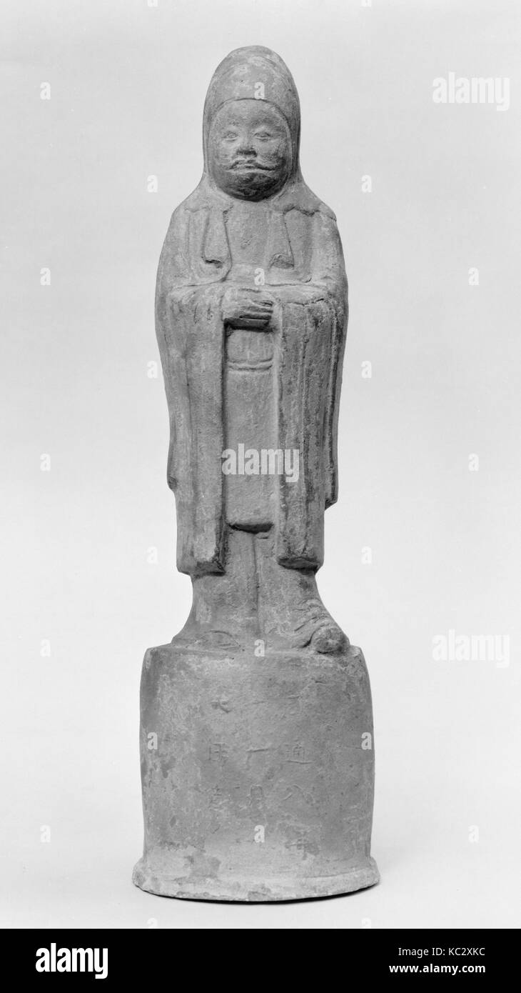 Official Standing on High Base, 9th century, China, Terracotta, H. 14 7/8 in. (37.8 cm), Tomb Pottery - Stock Image