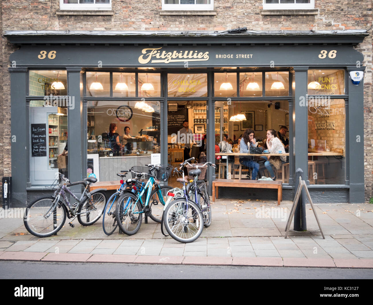 The new Fitzbillies restaurant and cafe in Bridge Street Cambridge UK at dusk with interior lights glowing Stock Photo