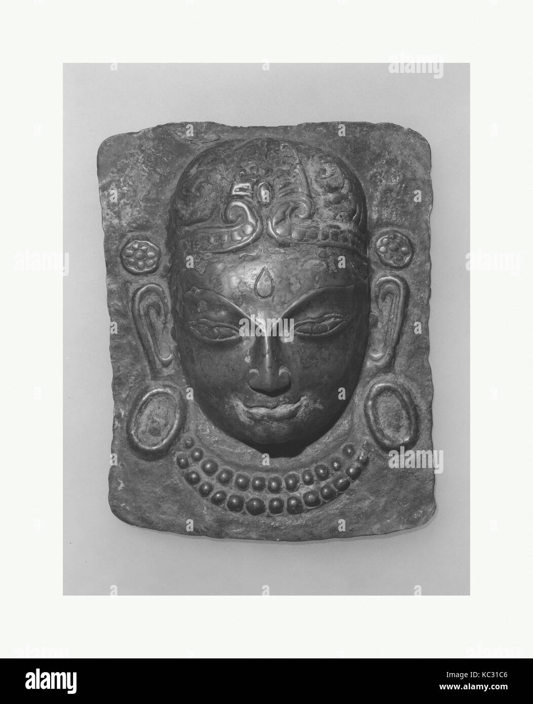 Relief Plaque of Hindu Deity, Probably Processional: Face of a Deity, probably 14th–16th century - Stock Image