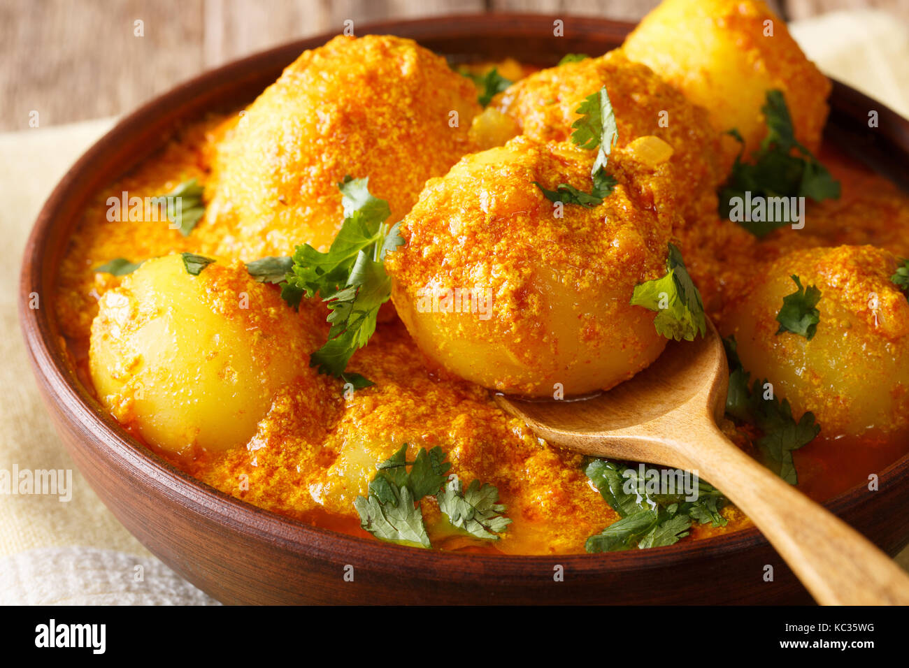 Kashmiri dum aloo: spicy potato closeup on the pan on the table. Horizontal - Stock Image