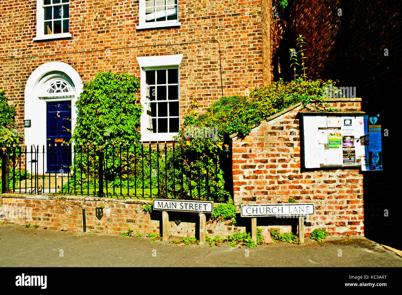 Main Street and church Lane, Nether Poppleton, North Yorkshire - Stock Image