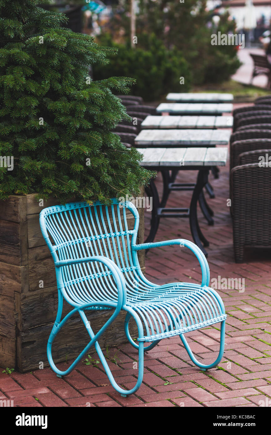 Design Vintage Furniture Of The Restaurant Outdoor. Blue Wicker Chair And  Wooden Table