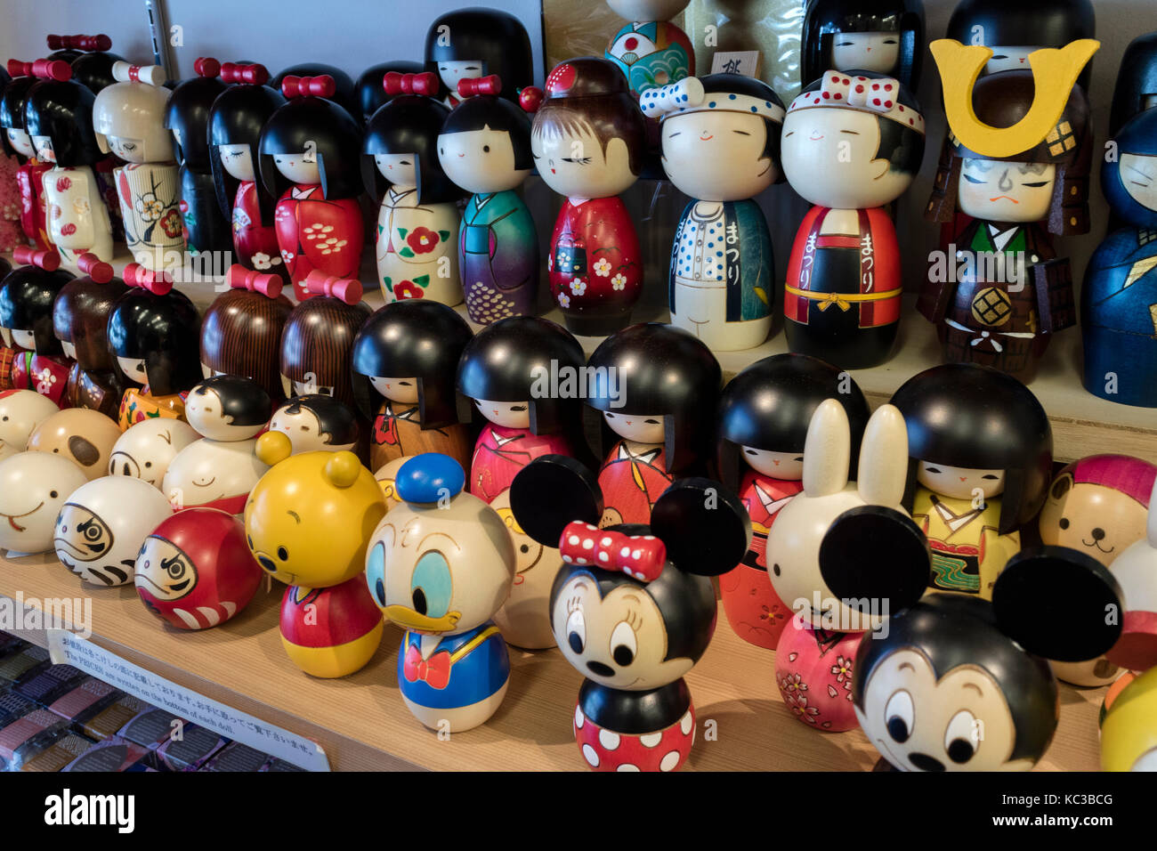 Kyoto - Japan, May18, 2017: Traditional wooden kokeshi dolls for sale as gifts or souvenirs - Stock Image