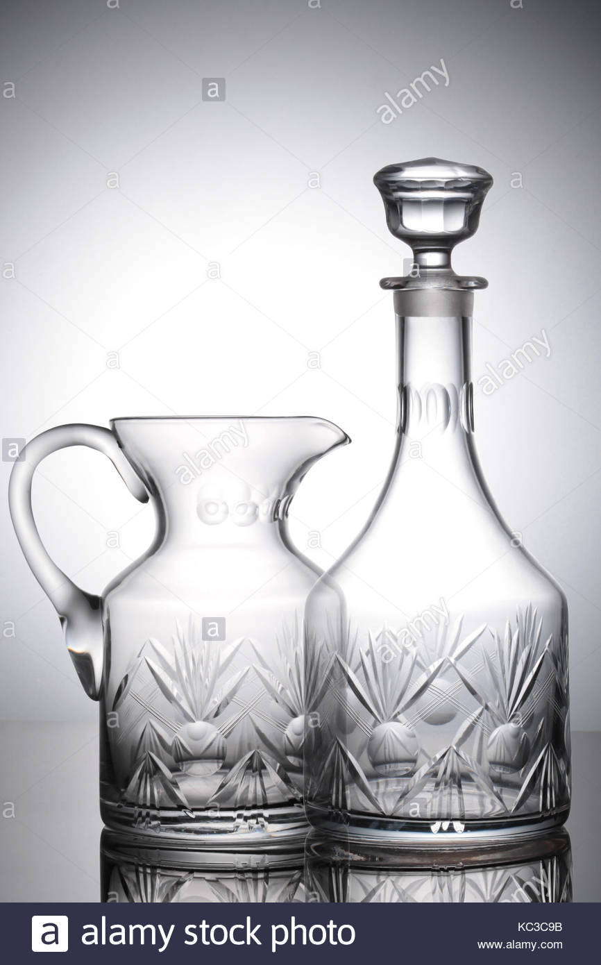 Bohemian refined pitcher and decanter crystals empty and transparents - Stock Image