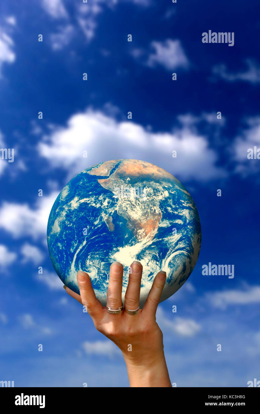 hand holding planet earth, save the planet concept - Stock Image