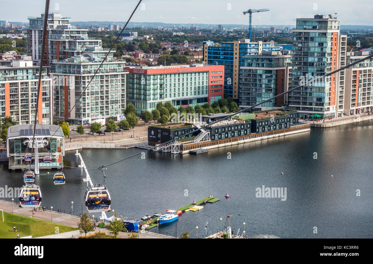 Emirates Air Line cable cars crossing the River Thames, between the terminals at Greenwich Peninsular and Royal - Stock Image