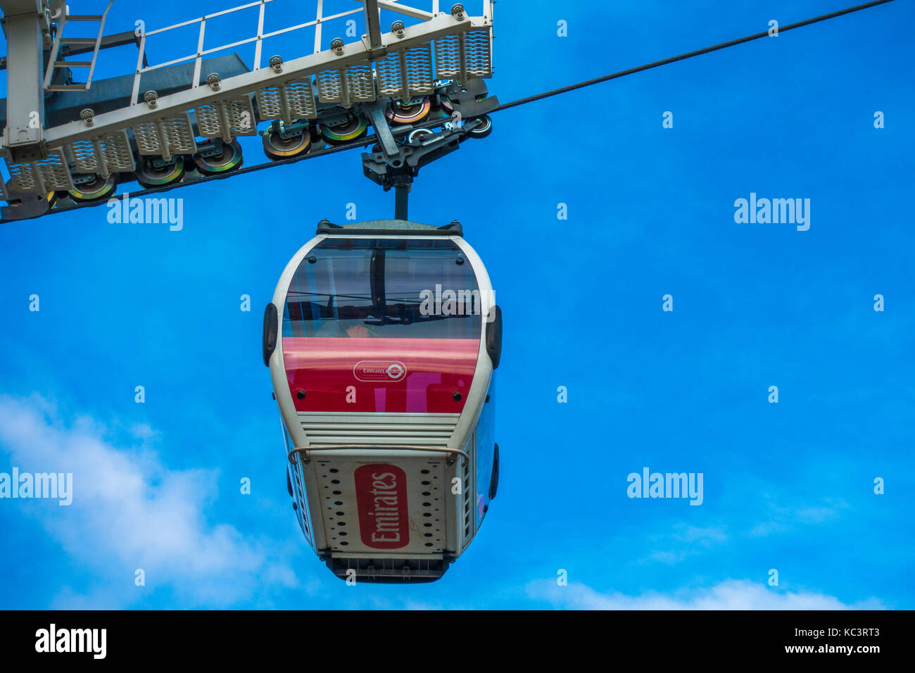 An Emirates Air Line cable car leaving the terminal to cross the River Thames, from Greenwich Peninsular to Royal - Stock Image