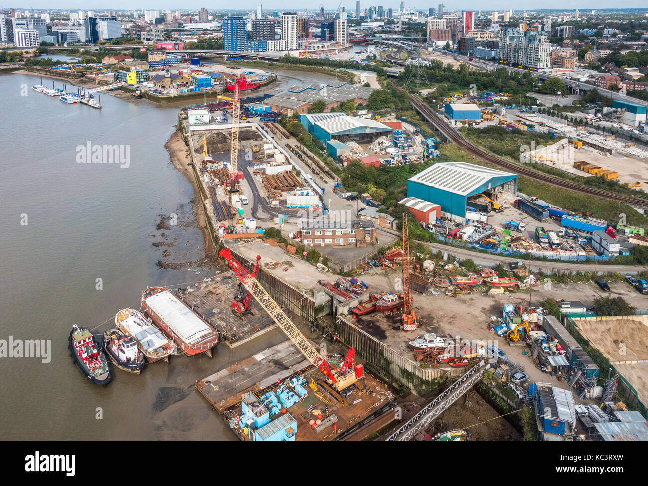 View from above of Royal Victoria Docks and Bow Creek tidal estuary, which divides the East London Boroughs of Newham - Stock Image
